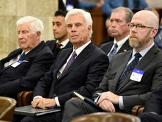 George Norcross, center, waits to testify for the first time before the New Jersey Senate select committee on Economic Growth Strategies in Trenton on November 18, 2019.