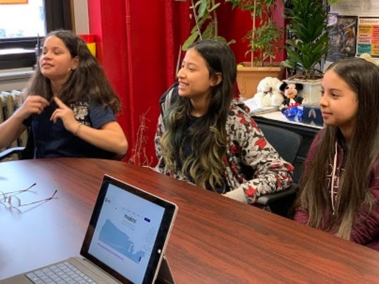 """Students working on School 8's project for the Samsung """"Solve For Tomorrow"""" contest are, from left to right, Karen Vargas, Ashley Martinez and Lorena Cruz."""
