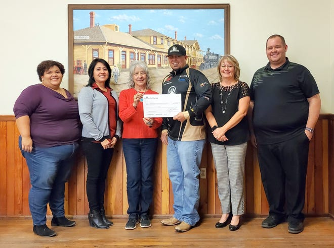 Bear Warrior Archery donated a check to the Cancer Support of Deming and Luna County Inc. The money for the check was raised through a benefit Aim for a Cure Bow Shoot that was held in October in recognition of Breast Cancer Awareness Month. Bear Warrior Archery and the archery competitors raised $1,500 for Cancer Support. Pictured from left are:Joanna Costilla (patient advocate), Lila Jasso (board member), Molly Glover (board member), Chuck Turner (Bear Warrior Archery), Kristie Hobbs (board member) and John Richmond (board member).