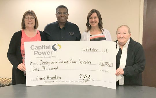 Pictured from left are: Joann McDonald, director of community relations; Macho Springs Wind Site Manager Derrick Perkins, Lindsay Cooper, senior adviser for community investments and Betteanne Strauss of the Deming-Luna County Crime Stoppers.