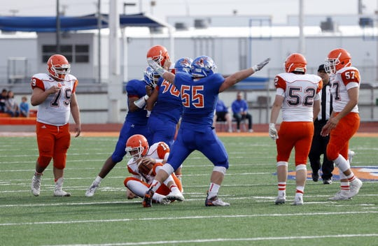 Los Lunas defensive tackle Zachary Doyle (55) celebrates one of his two sacks on Artesia's Clay Houghtaling during their 5A quarterfinals game on Nov. 16, 2019. Los Lunas won, 59-21.