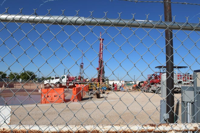 Crews prepare to drill grouting wells earlier this year at the former I&W Brine Well site south of Carlsbad.