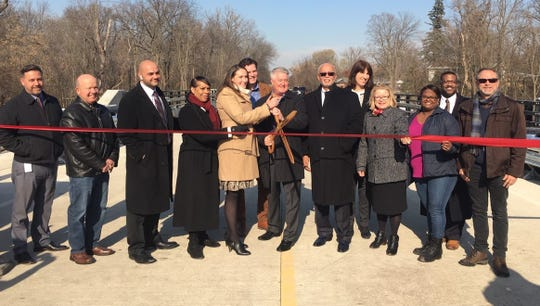 Wayne County and Canton Township dignitaries participated in the ribbon-cutting ceremony for the reopening of the Lilley Road bridge Monday afternoon.