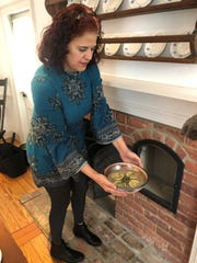 Donna Casaceli takes Jugged Hare from the warming oven at Birmingham Museum's Allen House.