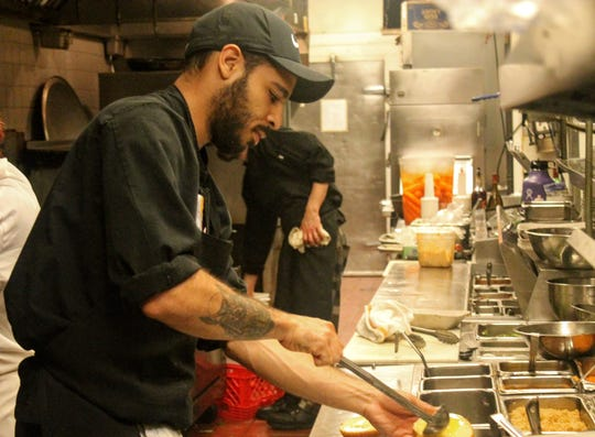 Chef Marcus Spivey prepares food Nov. 14 at Rocky's of Northville in Northville Township.