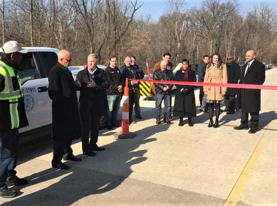 Canton Township Supervisor Pat Williams (third from left) and Wayne County Supervisor Warren Evans (second from left) spoke at the Lilley Road bridge reopening ceremony Monday, Nov. 18.