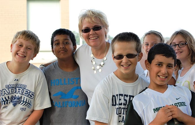 Erickson, pictured center, was known by her friends, family and colleagues as someone who was dedicated to students.
