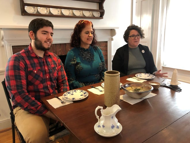 """Kyle Phillips, Donna Casaceli, and Caitlin Donnelly, Birmingham Museum assistants, record an episode of """"What were they thinking?"""" in which they try jugged hare, a recipe from the 1800s."""