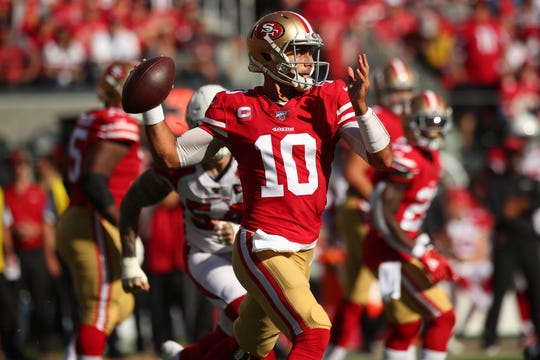 San Francisco 49ers quarterback Jimmy Garoppolo led a comeback victory over the Arizona Cardinals on Sunday to keep the 49ers atop the NFC.