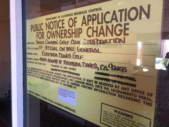 A public notice of sale for Bermuda Dunes Country Club on the winder of the clubhouse.