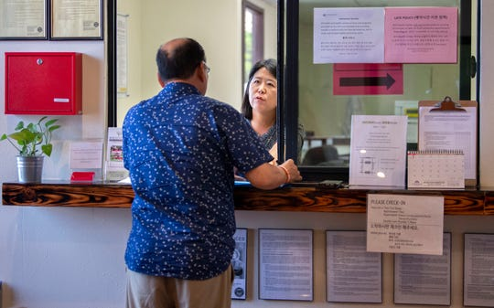 KCS Health Center appointment coordinator, Jenna Choi, helps a client in Buena Park on Tuesday, July 16, 2019. (Photo by Mindy Schauer, Orange County Register/SCNG)
