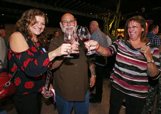 Lorene Tussey, Mitch and Julie Levy (right) students at Southwest Wine Center at Yavapai College celebrate after winning, Best In Show for their 2018 Viogner wine at the azcentral Arizona Wine Competition on Nov. 15, 2019 at the Westin Kierland Resort & Spa in Phoenix, Ariz.