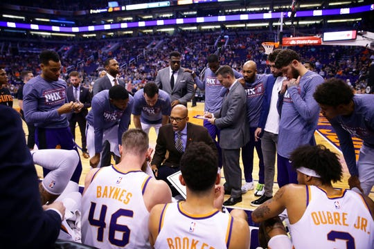 Phoenix Suns head coach Monty Williams huddles with his players during a timeout against the Atlanta Hawks in the first half on Nov. 14, 2019 in Phoenix, Ariz.