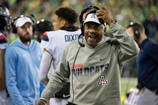 Arizona Wildcats head coach Kevin Sumlin complains to an official during the first half against the Oregon Ducks at Autzen Stadium.