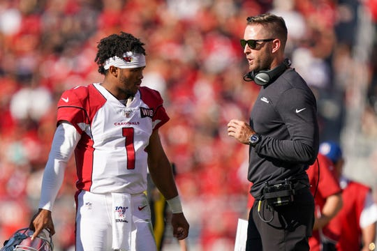 Cardinals coach Kliff Kingsbury talks to rookie quarterback Kyler Murray during a game Nov. 17 against the 49ers at Levi's Stadium.
