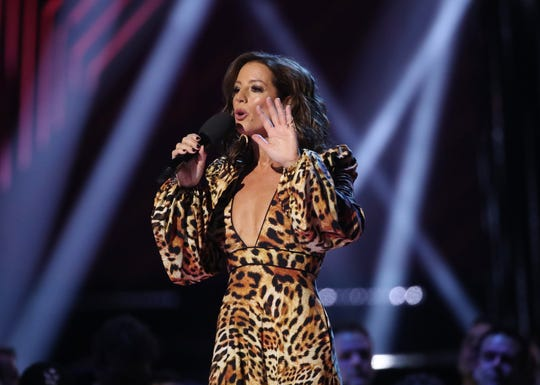 Sarah McLachlan speaks before presenting Corey Hart with an award for his induction into the Canadian Music Hall of Fame during the 2019 Juno Awards at Budweiser Gardens on March 17, 2019 in Canada. (