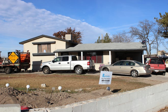 The outside of a West Valley City, Utah, home previously owned by Paul Petersen. Investigators say he housed as many as 15 pregnant Marshallese women in the house.