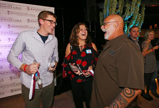 Michael Pierce, (left) the Director of Enology, Southwest Wine Center at Yavapai College celebrates with his students Lorene Tussey and Mitch Levy (right) after winning, Best In Show for their 2018 Viogner wine at the azcentral Arizona Wine Competition on Nov. 15, 2019 at the Westin Kierland Resort & Spa in Phoenix, Ariz.