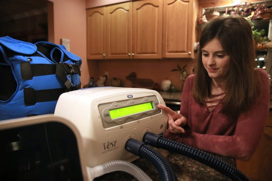 Rebecca Berak demonstrates the different apparatuses that she uses to maintain her respirator health while at her home in the Town of Poughkeepsie on November 14, 2019. Rebecca developed a severe lung infection which nearly killed her.