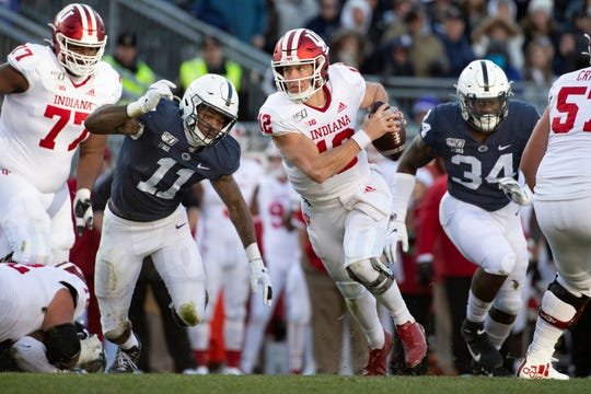 Penn State linebacker Micah Parsons (11) chases Indiana quarterback Peyton Ramsey on Saturday. Penn State's once-vaunted defense has allowed 58 points in the last two games. (AP Photo/Barry Reeger)