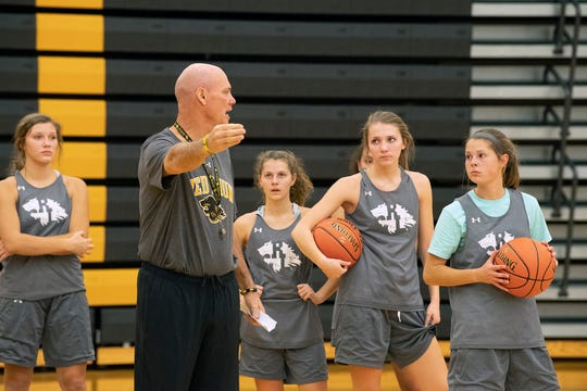 Coach Don Dimoff talks to players during basketball practice in Red Lion.