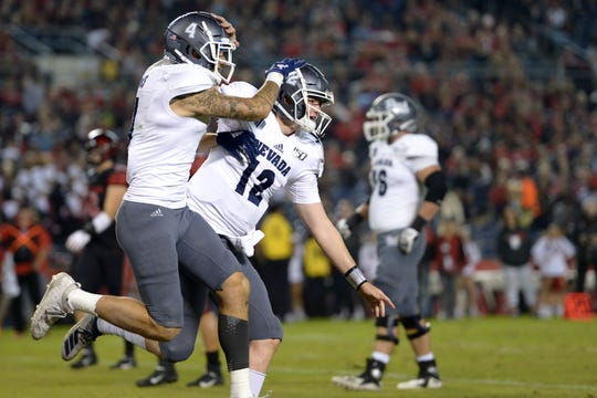 Nevada Wolf Pack quarterback Carson Strong (12) and wide receiver Elijah Cooks (4) celebrate a third quarter touchdown against the San Diego State Aztecs at SDCCU Stadium.