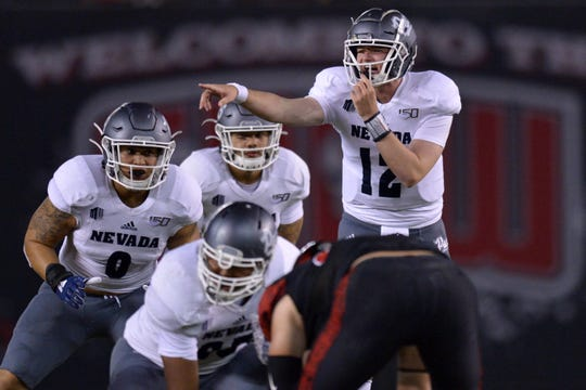 Nevada Wolf Pack quarterback Carson Strong (12) yells before the snap against the San Diego State Aztecs during the first quarter at SDCCU Stadium.