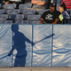 Long shadows are cast against the backstop at Dwyer Stadium during the Batavia Muckdogs home opener against State College.