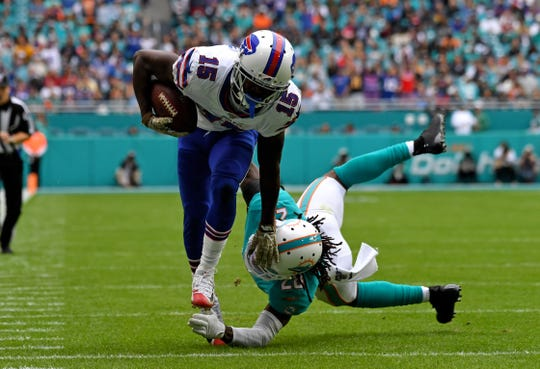 Buffalo Bills wide receiver John Brown (15) runs past Miami Dolphins strong safety Bobby McCain (28) for a touchdown during the first half of the Bills' 37-20 win at  Miami's Hard Rock Stadium on Sunday.