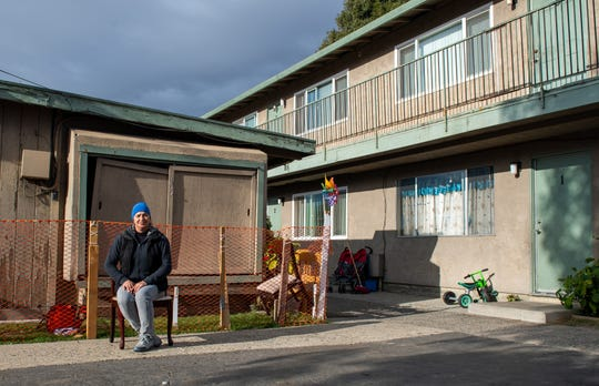 Eufemia Aguilar sits on a wooden chair in front of her apartment complex. This apartment complex is where she's lived for the past 10 years in a two-bedroom apartment on North Sanborn Road on Nov. 14, 2019.