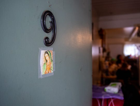 The front door of  Luz Hernandez's apartment is decorated with a picture of La Virgen on Nov. 14, 2019.