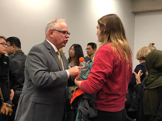 Gov. Tim Walz speaks with a student following a Q&A at SCSU on Monday, Nov. 18, 2019.