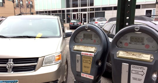 Parking meters line St. Germain Street in downtown St. Cloud on Monday, Nov. 18, 2019.