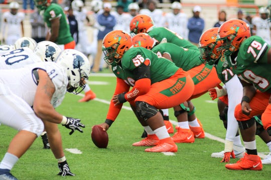 FAMU center Bryan Crawford (56) anchors the offensive line attack versus Howard on Nov. 16, 2019.