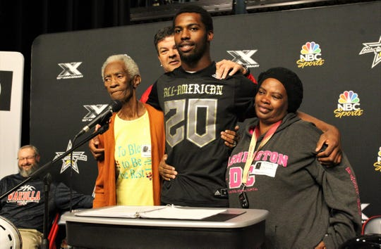 Wakulla senior linebacker Keyshawn Greene, a four-star prospect committed to Florida State, was named a U.S. Army All-American on Monday, Nov. 18, 2019 during a ceremony at Wakulla High School. He was surround by his grandmother Mattie Greene, War Eagles head coach Scott Klees, and mother Kimberly Greene.