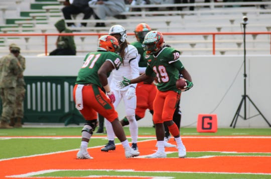 FAMU wide receiver Xavier Smith (19) celebrates a touchdown versus Howard with tight end Kamari Young on Nov. 16, 2019.