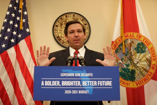 Gov. Ron DeSantis shares the 2020-2021 budget during a news conference Monday.