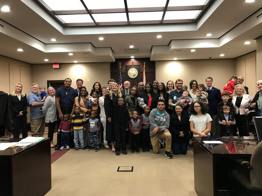 Familes gathered Monday morning, Nov. 18, 2019, at the courthouse to celebrate finalizing their adoptions a week early for National Adoption Day in Tallahassee.