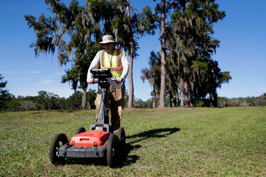Andrew McFeaters, an archeological technician, uses a ground penetrating radar to search for any signs of unmarked graves at the Capital City Country Club golf course on Monday, Nov. 18, 2019.