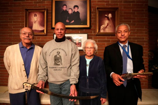 Dr. A. D. Brickler, left, and his wife Dorothy Brickler, pose for a photo with their sons A.J. Brickler III, who is holding Harriet Tubman's sword, and David Brickler, who is holding Tubman's pistol. The Bricklers are related to Harriet Tubman.