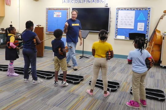 Jimmy Gillis's violin students gain confidence and problem solving skills.
