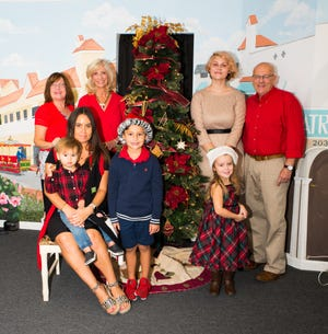 Main Street Vero Beach is getting ready for the Nov. 29 Downtown Friday, which will feature Santa Claus. Pictured are, from left, back row: Sue Gromis, Elaine Jones, Miss Hibiscus Rebekah Parsons and Chris Beals, with front row, Carissa Cameron and her children, Roman, 2, Cruz, 6, and Mila, 3.