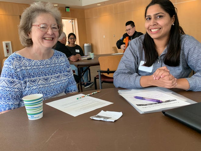 Ida O' Donoghue, left, helps lead the Communication Café at California Lutheran University, and Kala Nidhi, right, has been a participant. Through the program, senior residents of University Village help foreign students improve their English skills.
