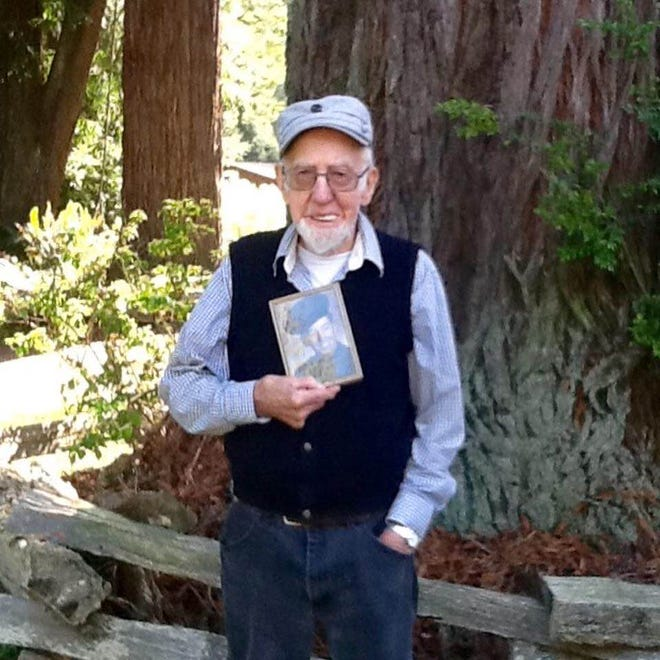 Korean War veteran Tony Dantzman went missing from Winter on Aug. 30. He's shown here holding a photo of himself while he served in the Marines.