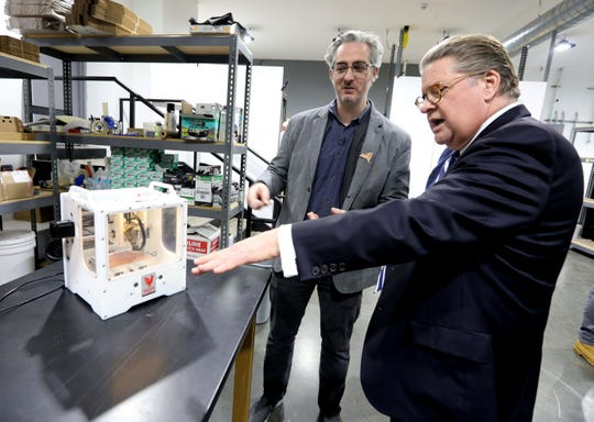 Bre Pettis, left, owner of Bantam Tools, shows State Senator Pete Harckham the desktop size PCB Milling Machine that Bantam Tools will be producing at their new facility in Peekskill Nov. 18, 2019. The milling machine produces devices such as prototypes of circuit boards, and is also used for metal engraving for uses in jewelry making and other industries. The company held a grand opening ceremony Monday.
