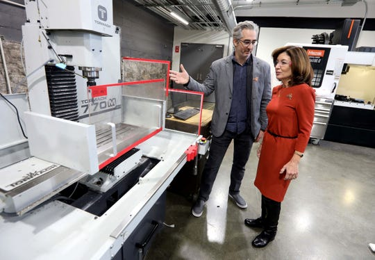 Bre Pettis, left, owner of Bantam Tools, shows Lieutenant Governor Kathy Hochul his company's new site in Peekskill Nov. 18, 2019. The company held a grand opening ceremony Monday. Bantam Tools will be producing prototypes of a desktop PCB Milling Machine that is used to produce circuit boards, and is also used for metal engraving for uses in jewelry making and other industries.