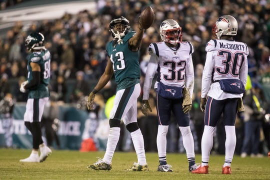 Eagles' Nelson Agholor (13) signals for a first down during the Sunday, Nov. 17, 2019 game against the Patriots.