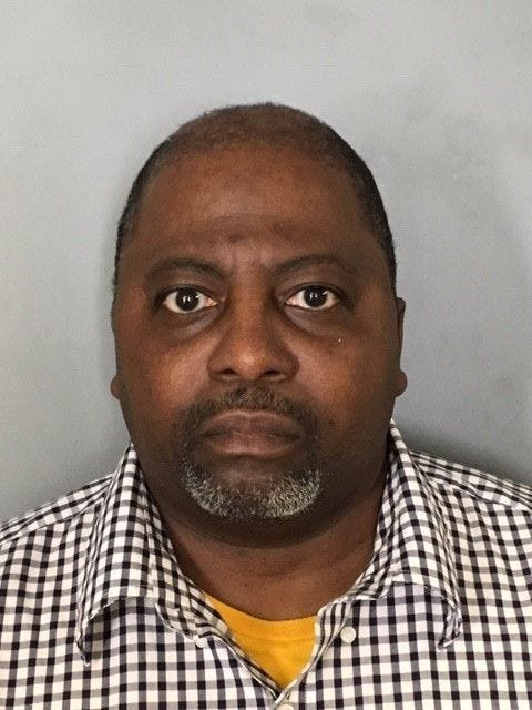 Newark police charge an employee after camera found in women's bathroom in Patterson-Schwartz's office
