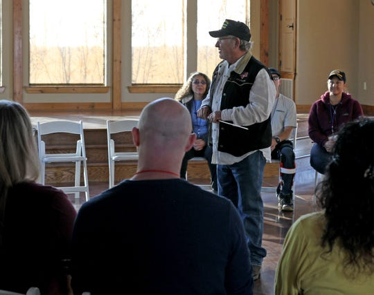 Harry Patterson talk to veterans and their spouses at the welcome ceremony of the Veteran Freedom Retreat Sunday, Nov. 18, 2019, at Coyote Ranch Resort. The couples retreat is to help veterans suffering from post-traumatic stress disorder with experiential education, counseling, equine therapy, and other stress reduction activities.