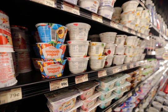 FILE - This July 11, 2018, file photo shows yogurt on display at a grocery store in River Ridge, La. Despite shelves full of new varieties, from Icelandic to Australian to coconut-based, U.S. yogurt sales are in a multiyear slump. Yogurt companies are confident that more new products can boost sales. But some analysts are skeptical, saying larger trends - like growing sales of breakfast protein bars - will be hard to turn around.